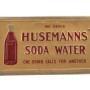 Husemann Soda Water Tin Over Cardboard Sign