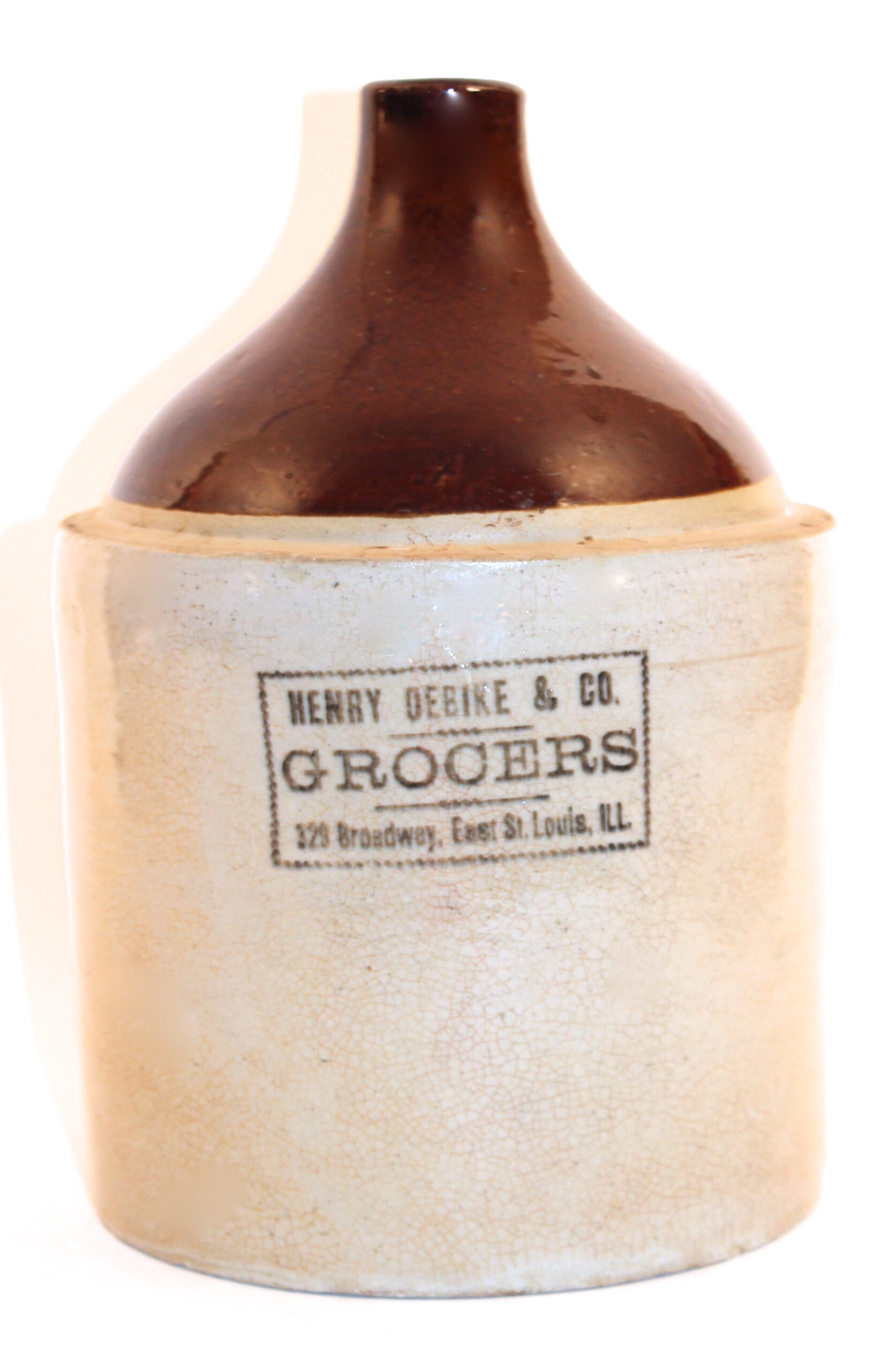 Henry Oebike & Co Grocers Whiskey Jug, E. St. Louis, IL. Circa 1900