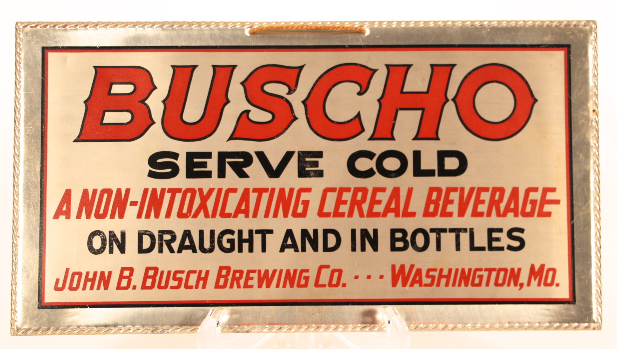 Buscho Cereal Beverage Tin Sign, John B. Busch Brewing Co., Washington, MO. Circa 1918