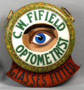 C. W. FIFIELD OPTOMETRIST OUTDOOR HANGING TRADE SIGN. Ca. 1900